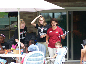 Head coach Tia Brandel-Wilhelm welcomes everyone to the 2010 Serve It Up! picnic event.  (Photo by Joe Gorby)