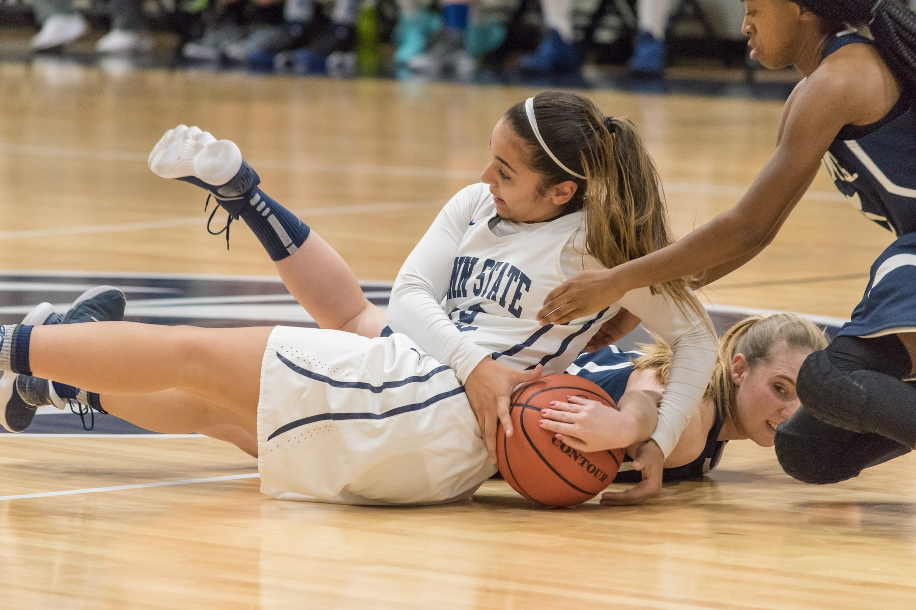 Corina Rivera (white jersey) fights for a loose ball against Penn State Fayette Friday, Jan. 19.