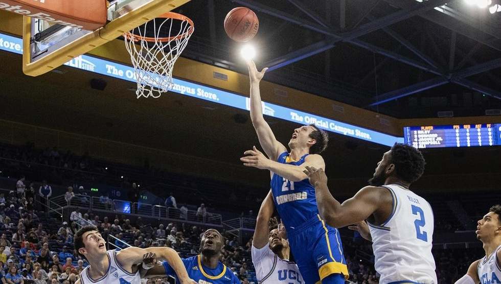 Max Heidegger takes the ball to the basket at UCLA on Sunday night. (Photo by Eric Isaacs)