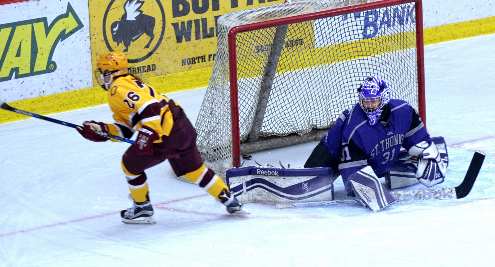 Junior Tori Davis slides the puck on a breakaway in the third period of the Cobbers' win over St. Thomas. The goal was the game winner and Davis' 10th of the year.