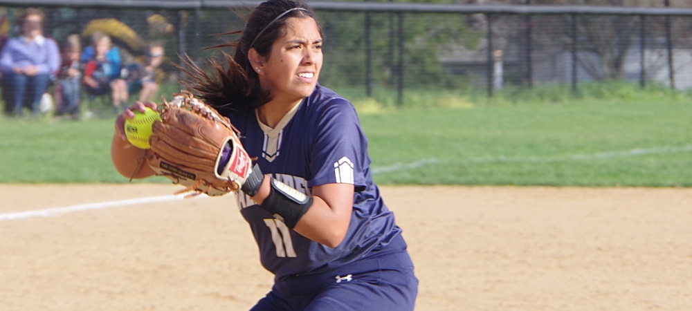 Gallaudet softball pitcher Jacklyn Zacarias makes a throw towards first base on a sunny afternoon.