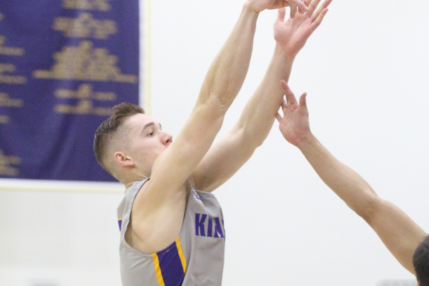 Kyle Ferreira scores his 1,000th-career point with the Kingsmen. (Photo: Danielle Roumbos)