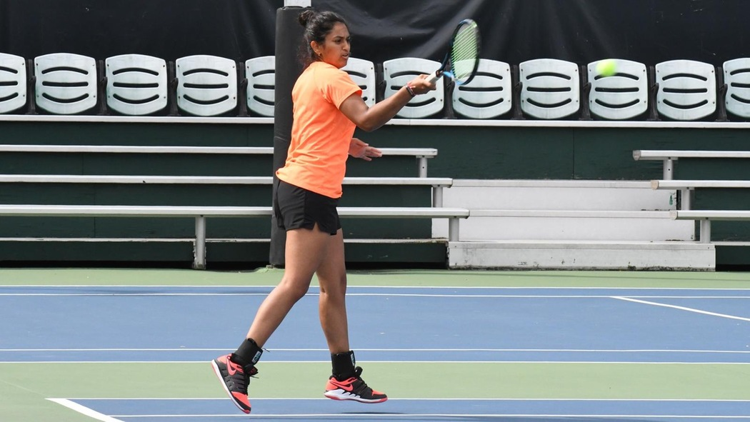 Sonal Bahl playing tennis.