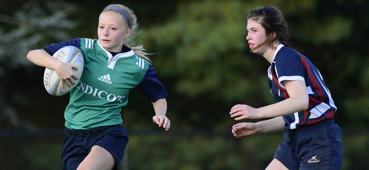 Nicole McCardle runs past a defender.