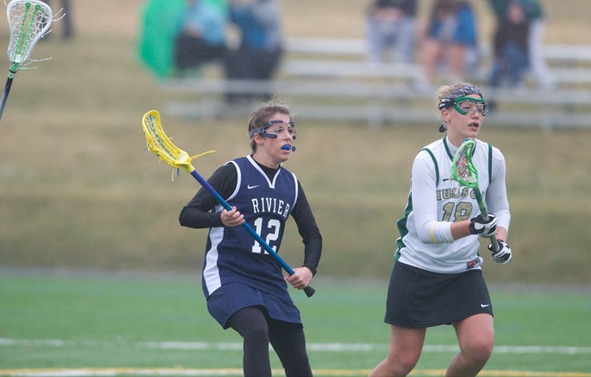 Second Half Surge Helps Rivier Past Husson