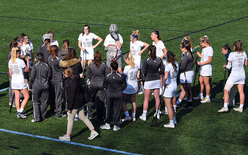 The Greyhounds talk during a timeout in a match versus Elizabethtown College on John Makuvek Field during the 2018 season.