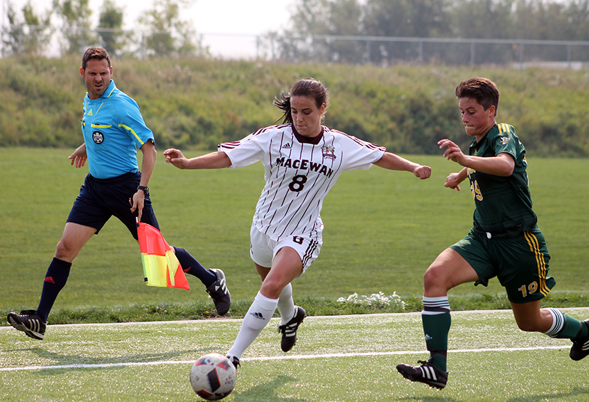MacEwan striker Meghan Oram turns the corner on UNBC defender Mara McCleary in Canada West preseason action on Friday in Edmonton (Jefferson Hagen photo).