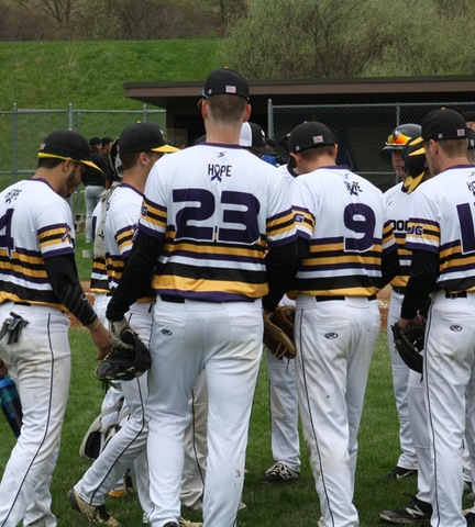 Baseball team huddling before the start of game one