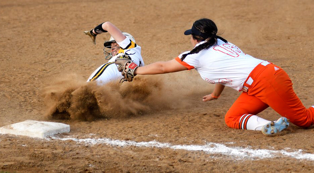 Taft College's Gillian Hale slides in safe at third under tag by West Valley Colleges Mariah Perez in home opener Friday. Photo by Taft Midway Driller / @midwaydriller