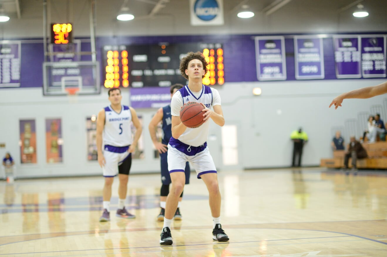 Purple Knights Hold On For 68-66 ECC Home Men's Basketball Triumph Over St. Thomas Aquinas