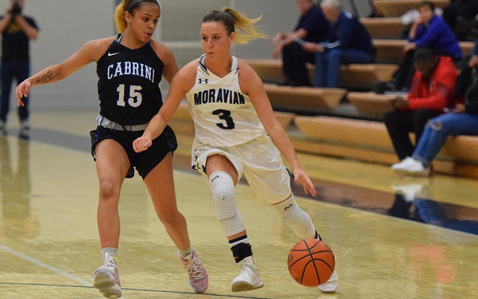 Maddie Capuano drives to the basket versus Cabrini University in the 16th Steel Club Classic.