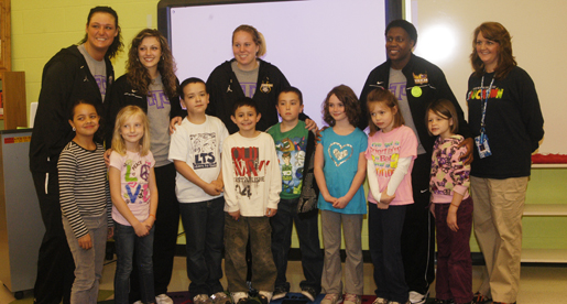 Golden Eagle women's basketball players visit Prescott Elementary