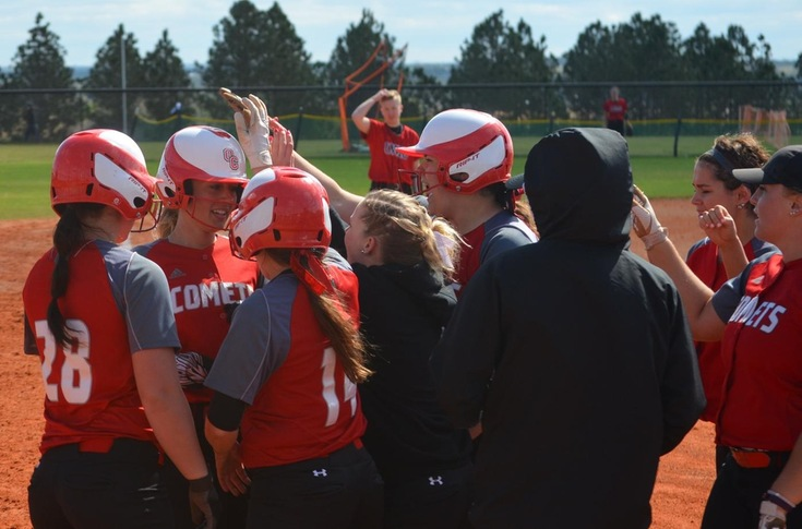 Taylor Smith is congratulated by her teammates after hitting her second home run against Wis.-River Falls.