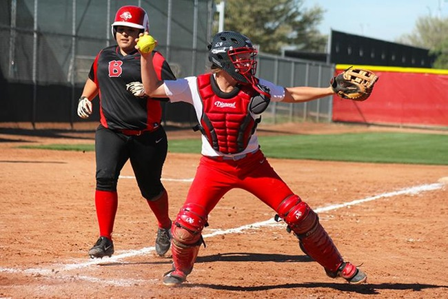 Catcher Tori Gonzalez looks to turn a double play Tuesday against Benedictine JV. (photo by Aaron Webster)