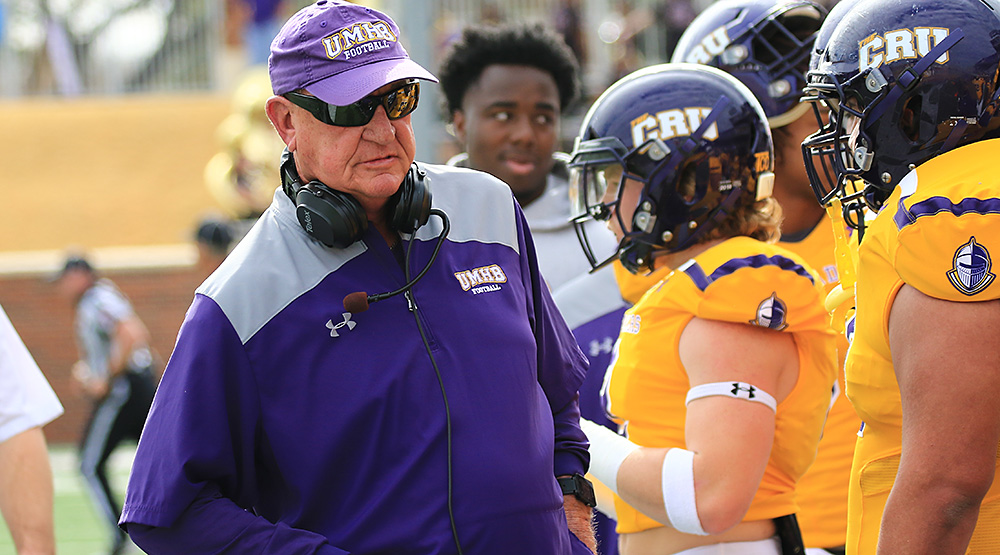Pete Fredenburg on the sidelines in the second-round playoff game against Berry, wearing sunglasses. (Photo by Joe Fusco, d3photography.com)