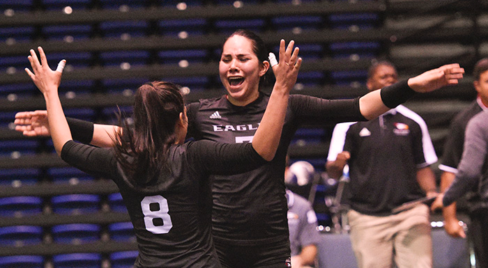 Cristina Castillo and Kathya Garcia celebrate after the Eagles rallied to defeat Palm Beach. (Photo by Tom Hagerty, Polk State.)