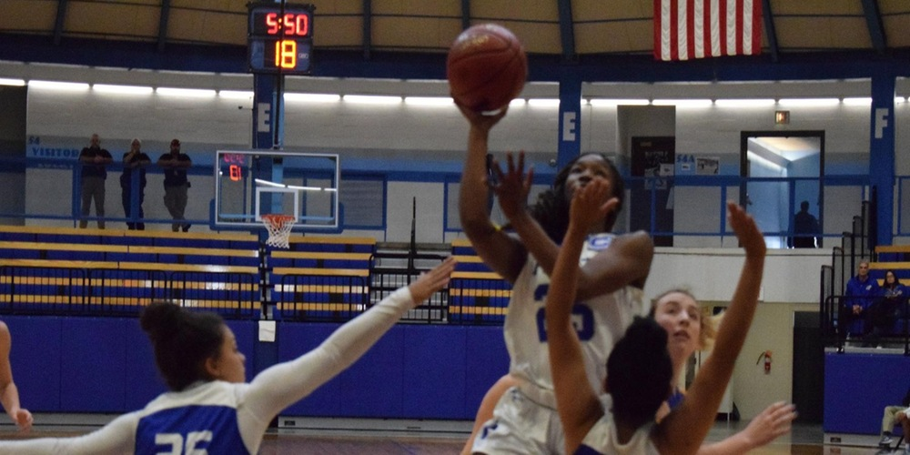 Courtney Cleveland takes a layup against the Tabor defense.