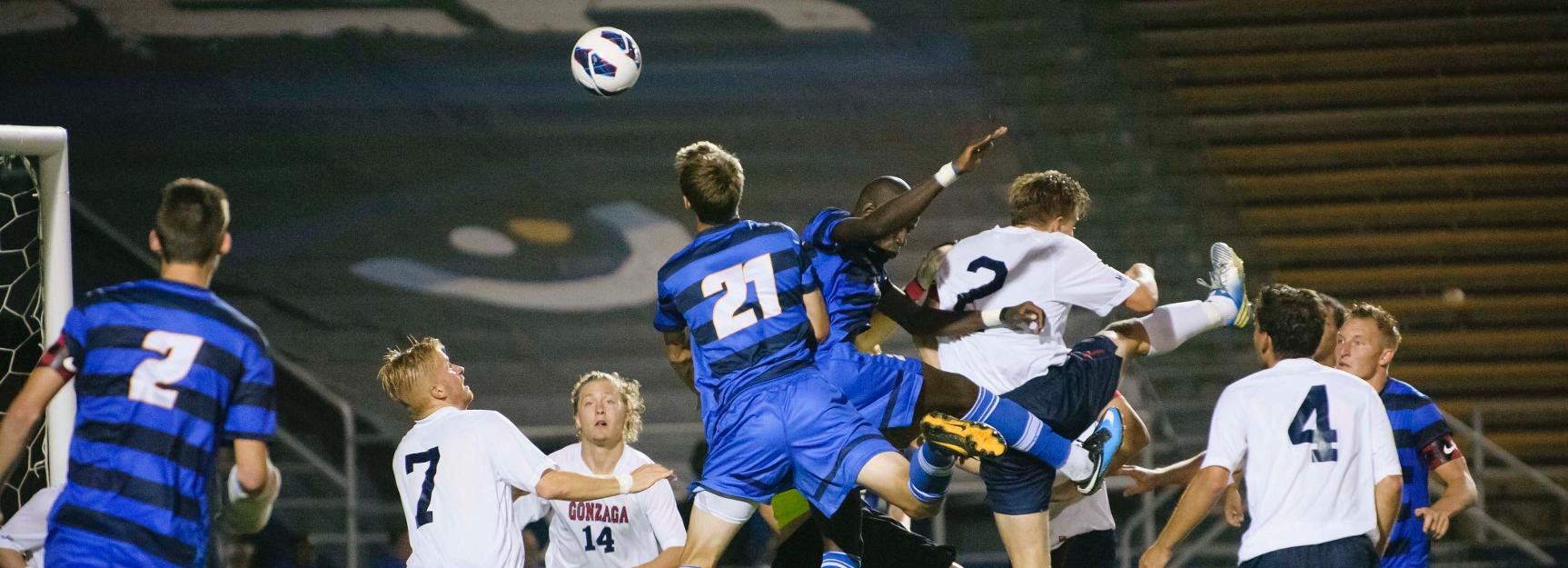 Nick DePuy and Goffin Boyoko fight to win a header (Photo by Tony Mastres)