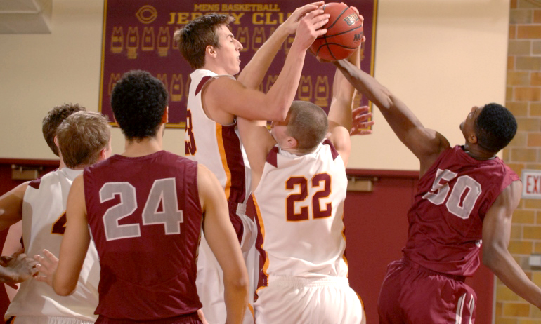 Jordan Bolger goes above the crowd to rip down one of his game-high eight rebounds in the Cobbers' win over Hamline.