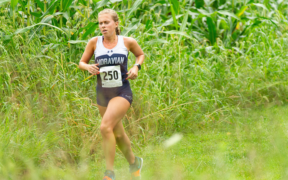Junior Katie Mayer runs during the Bulldog Invitational at DeSales University to begin the season. Photo courtesy of Patrick Jacoby, DeSales Athletic Communications