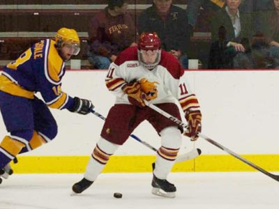 Ferris' Jordie Johnston battles for the puck in Sunday's exhibition game versus Wilfrid Laurier.