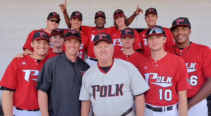Jim Selph (center) who played for Polk State's first baseball team 50 years ago, poses with players and Head Coach Al Corbeil before today's game. (Photo by Tom Hagerty, Polk State.)