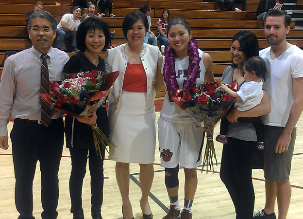 Kimi Takaoka (center) is honored on Senior Night