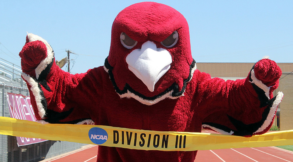 The D3 finish line, being crossed by the McMurry mascot