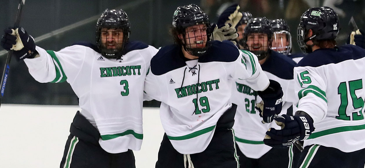 Logan Day celebrates a goal with his teammates.