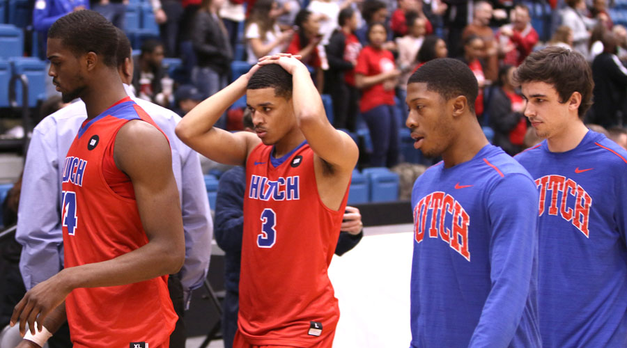 The Blue Dragon men's basketball team reacts to an 82-80 loss to Coffeyville in the Region VI Tournament Championship Game on Wednesday at Hartman Arena in Park City, KS. (Joel Powers/Blue Dragon Sports Information)