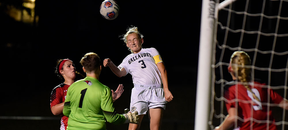 Gallaudet women's soccer player Sabina Shysh goes up to head the ball against Bryn Athyn College.
