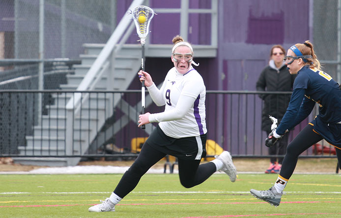 Women's Lacrosse Falls to No. 19 New Haven, Moyna Registers Seven-Point Day