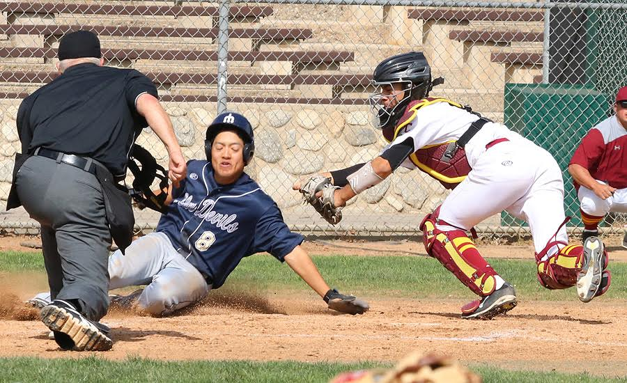 PCC catcher Jessie Garcia applies the tag at home plate to prevent a run in Thursday's loss to Merced, photo by Richard Quinton.