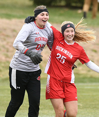 Dickinson goalkeeper and rookie defender Sarah Hughes celebrate a win over Amherst College in the 2019 NCAA Tournament