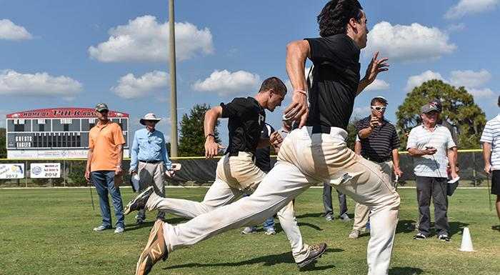 Scouts watch as Kaylor Kulina and Brandon Gali show their sprinting skills. (Photo by Tom Hagerty, Polk State.)