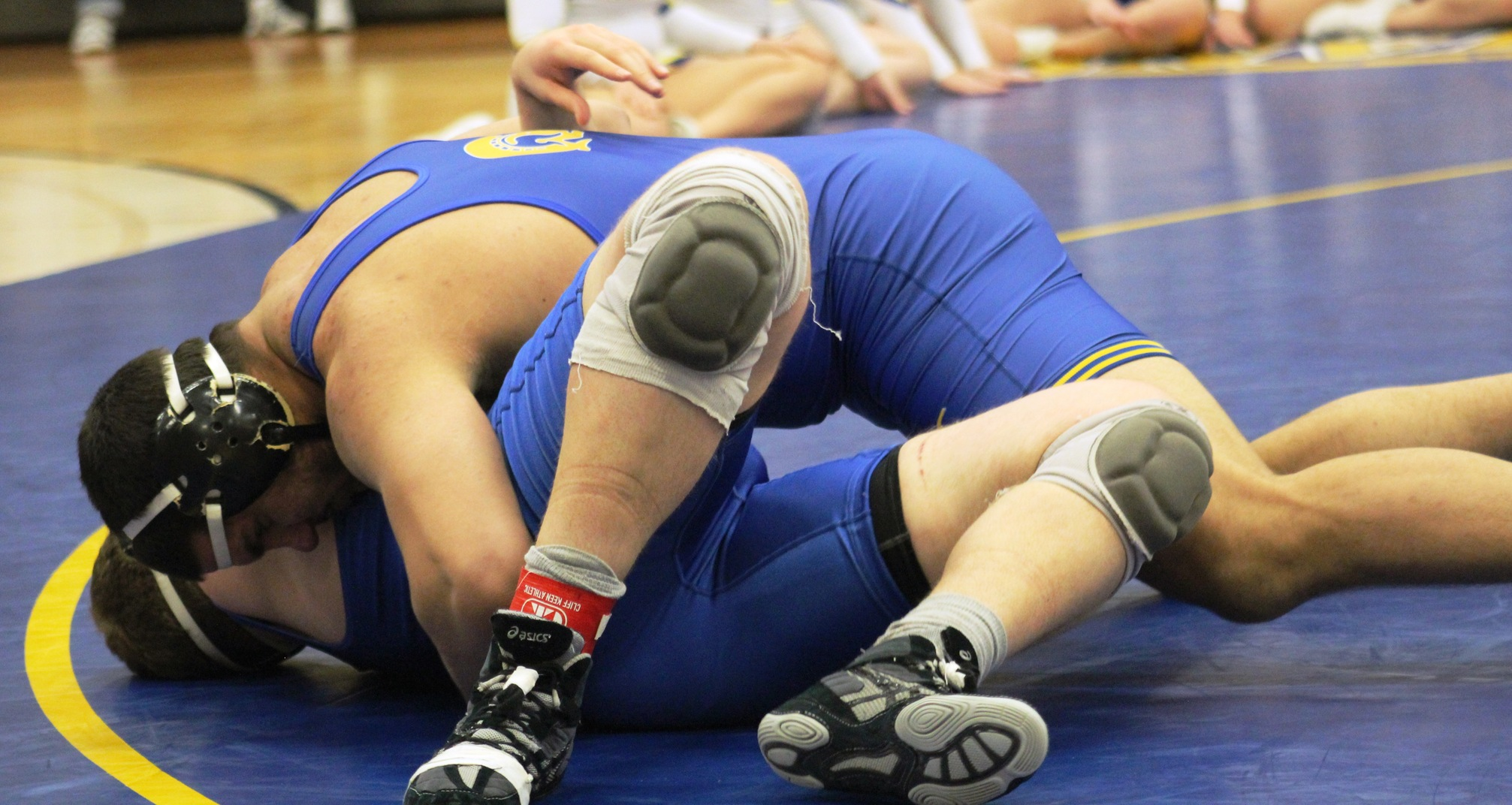 NIACC's Jimsher Sidhu works for the fall against Iowa Lakes' Montana Fuller in Friday's dual meet in the NIACC gym.