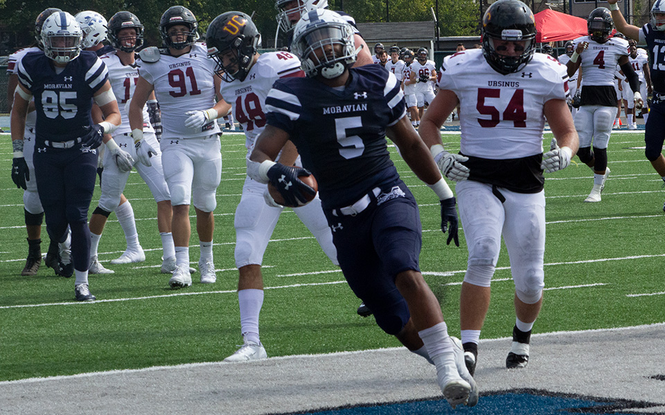 Roberto Diez gets into the end zone with the first of three touchdowns versus Ursinus College at Rocco Calvo Field.