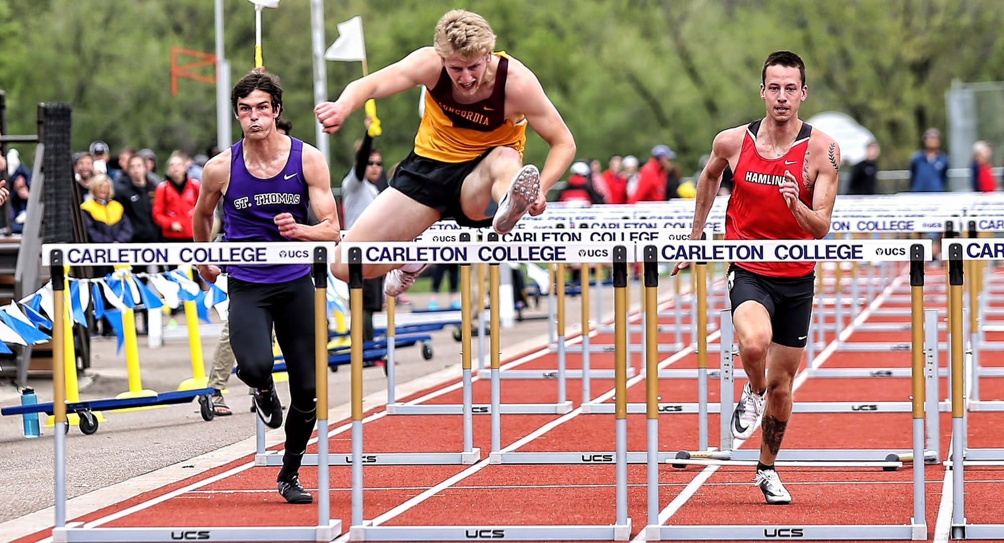 Sophomore Matt Bye clears the final hurdle on his way to a second-place finish in the 110-meter hurdles on Day 2 at the MIAC Championship Meet. (Photo courtesy of Nathan Lodermeier)