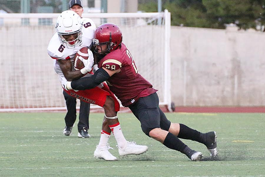 Freshman safety Andy Reyes makes the open field tackle during PCC's season-opening loss Saturday night v. Long Beach City College, photo by Richard Quinton.