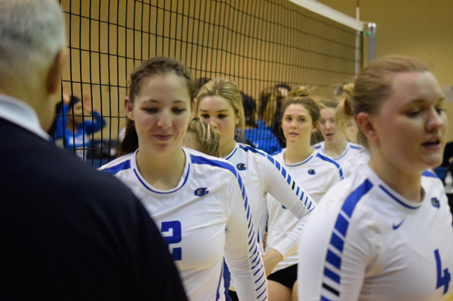 Women's volleyball clinch playoff berth in sweep over Huskies