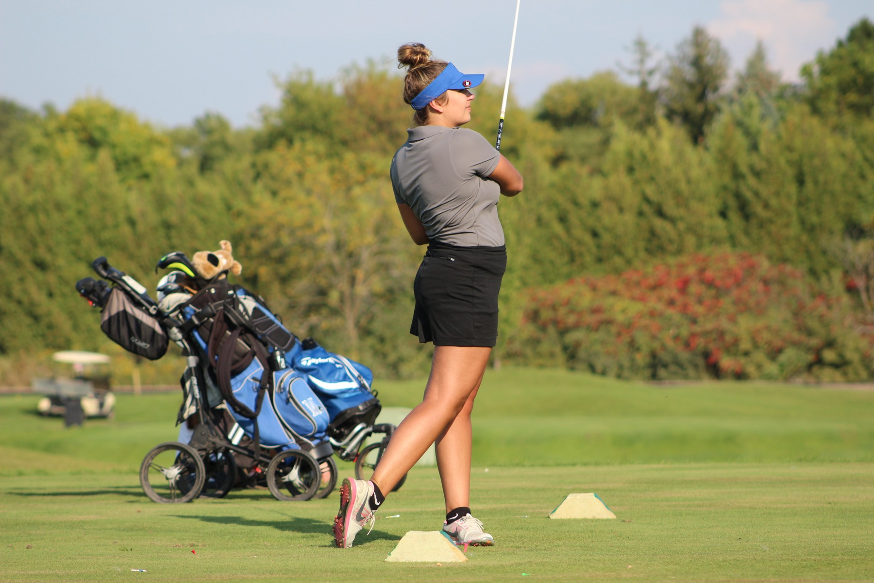 Taylor Lockhart watches her ball off of the tee.