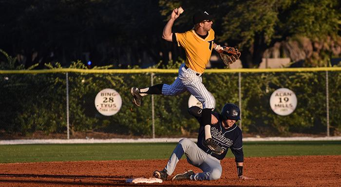 Cody Burgess leaps to turn a double play against St. Johns River in tonight's 11-3 win. (Photo by Tom Hagerty, Polk State.)