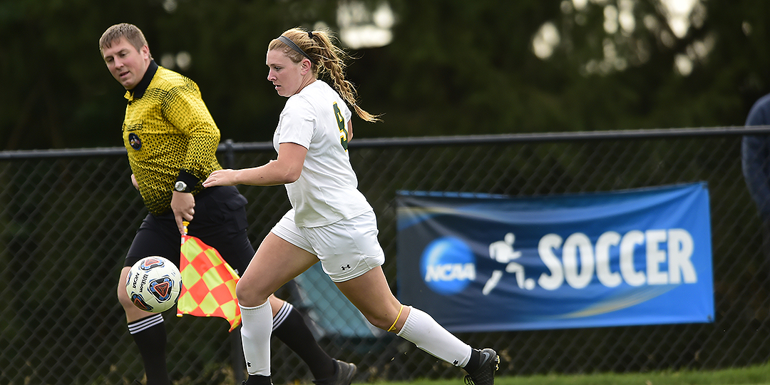 Maddie Schwartz kicks the ball down the sideline.