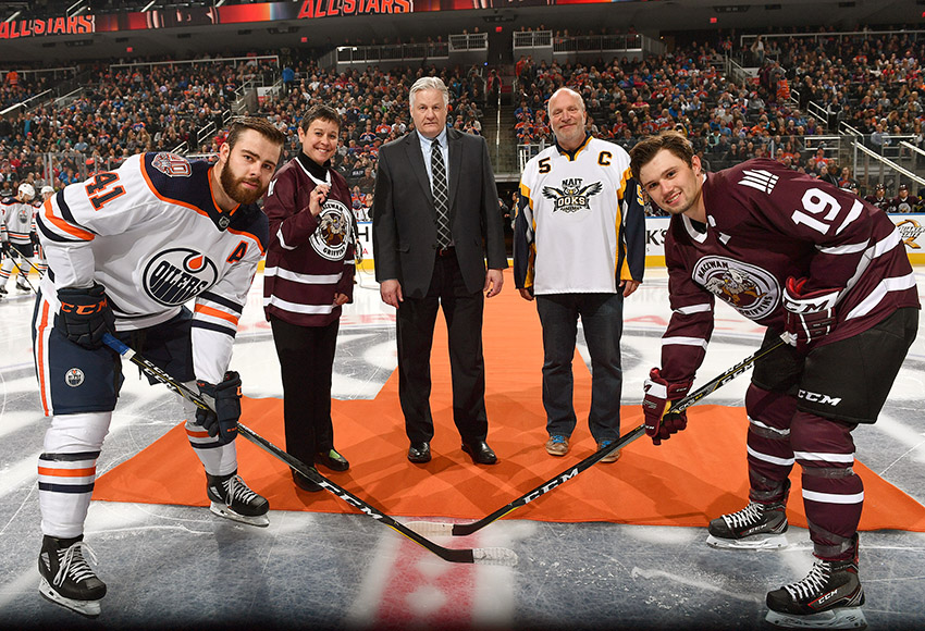 Cam Gotaas, right, seen participating in the puck drop ceremony prior to Sept. 11's NAIT-MacEwan All-Stars game against the Edmonton Oilers Rookies at Rogers Place, kicked off the 2018-19 season with a bang, netting seven points in two weekend road games (Andy Devlin, Edmonton Oilers).
