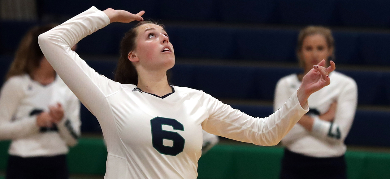 Colleen McAvoy swings at a volleyball.
