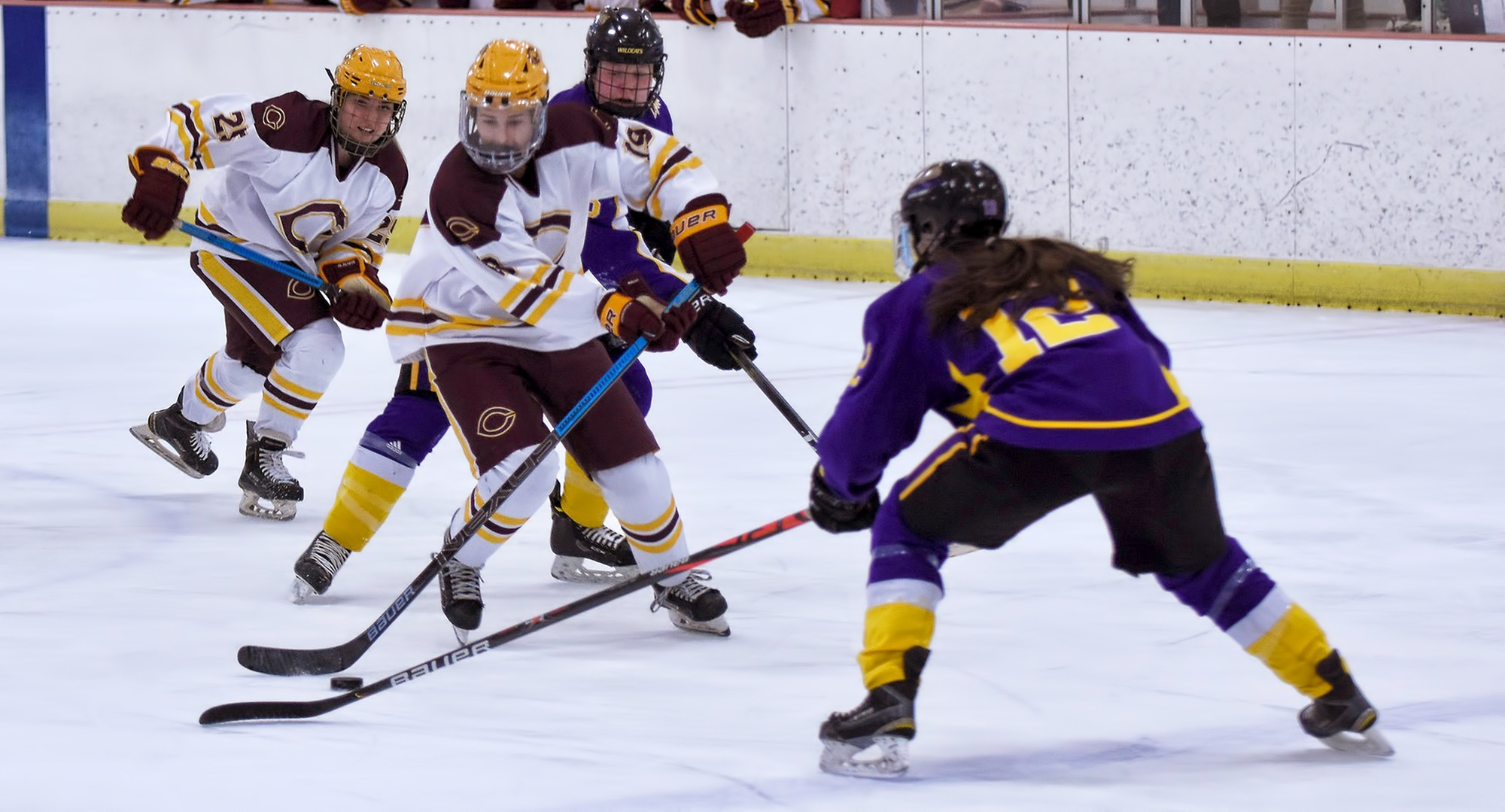 The Cobbers bring the puck up the ice during their series finale with St. Kate's.