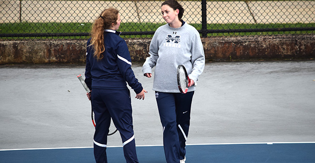 Emma Angle '21 and Kate Rennar '19 talk strategy during a doubles match versus Ursinus College at Hoffman Courts.