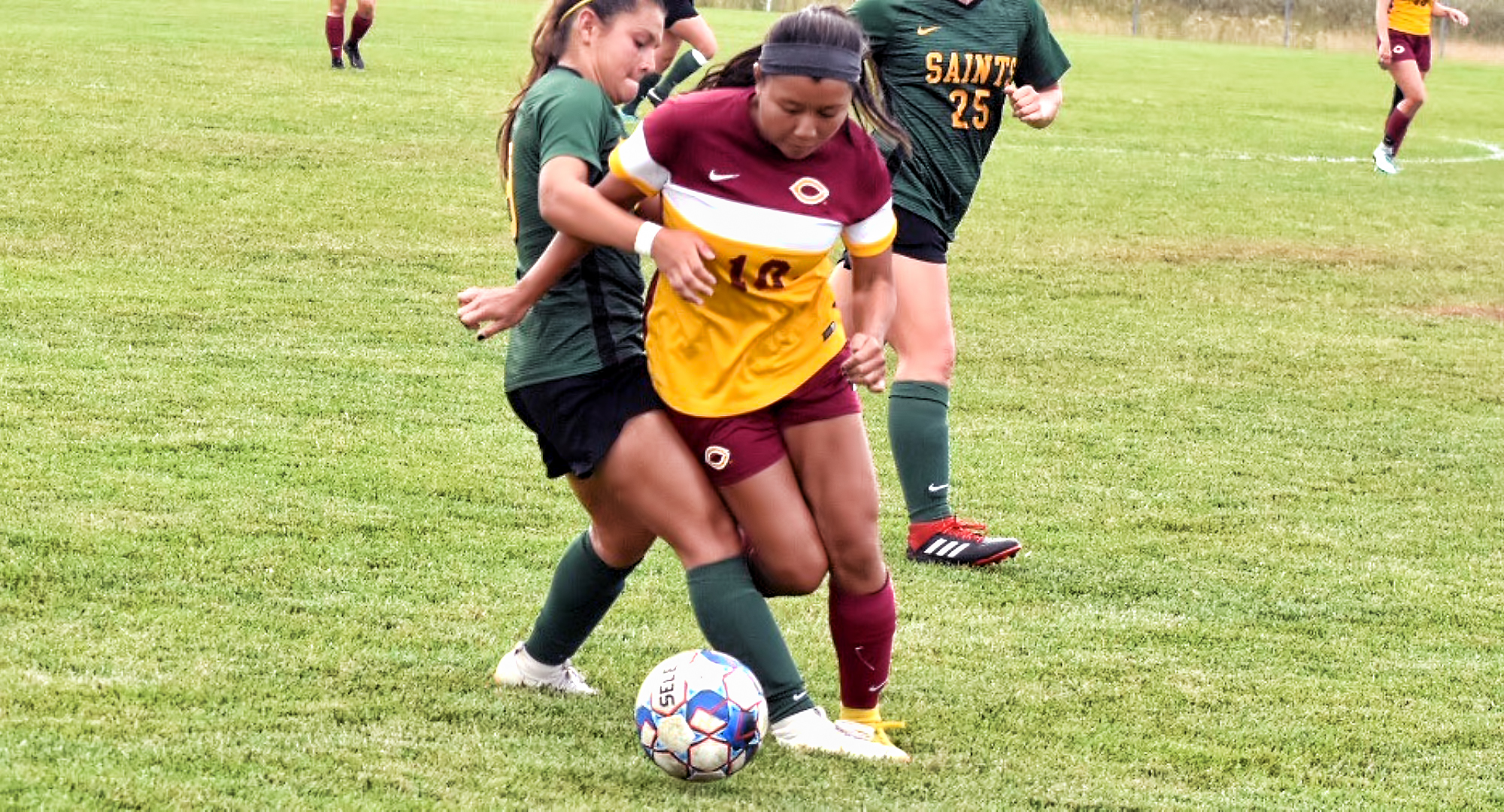Sophomore Kay Franzese takes control of the ball against a Presentation defender. She scored the game-winning goal which was her first collegiate strike. (Photo courtesy of Vince Arnold)