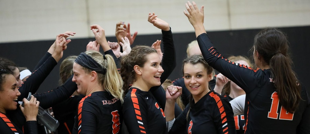 Kalamazoo College Women's volleyball team celebrating.