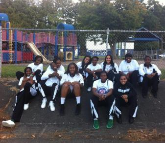 Members of the Felician women's basketball team pose in front of the playground at Rutherford Memorial Park.